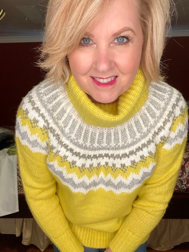 Fashion Blogger 50 Is Not Old is wearing a yellow turtleneck sweater