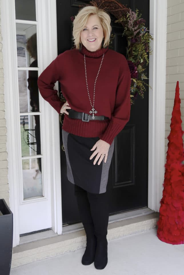 A burgundy oversized sweater and a pencil skirt worn by blogger 50 Is Not Old