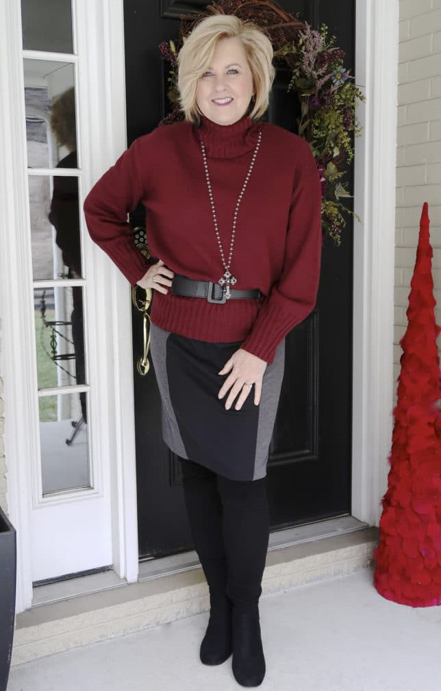 A belted burgundy oversized sweater a pencil skirt, and over the knee boots worn by blogger 50 Is Not Old