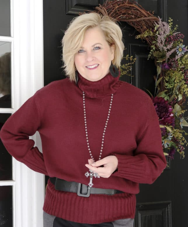 A burgundy oversized sweater with a cross necklace worn by blogger 50 Is Not Old