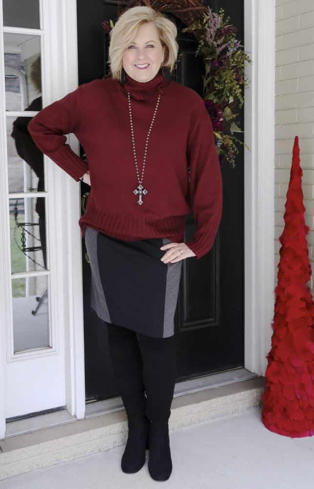 A burgundy oversized sweater and a knit pencil skirt worn by blogger 50 Is Not Old