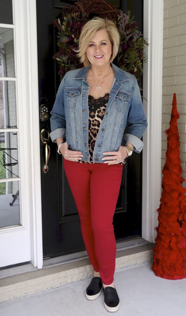 February is the month of love, fashion blogger 50 Is Not old is wearing red jeans and a denim jacket