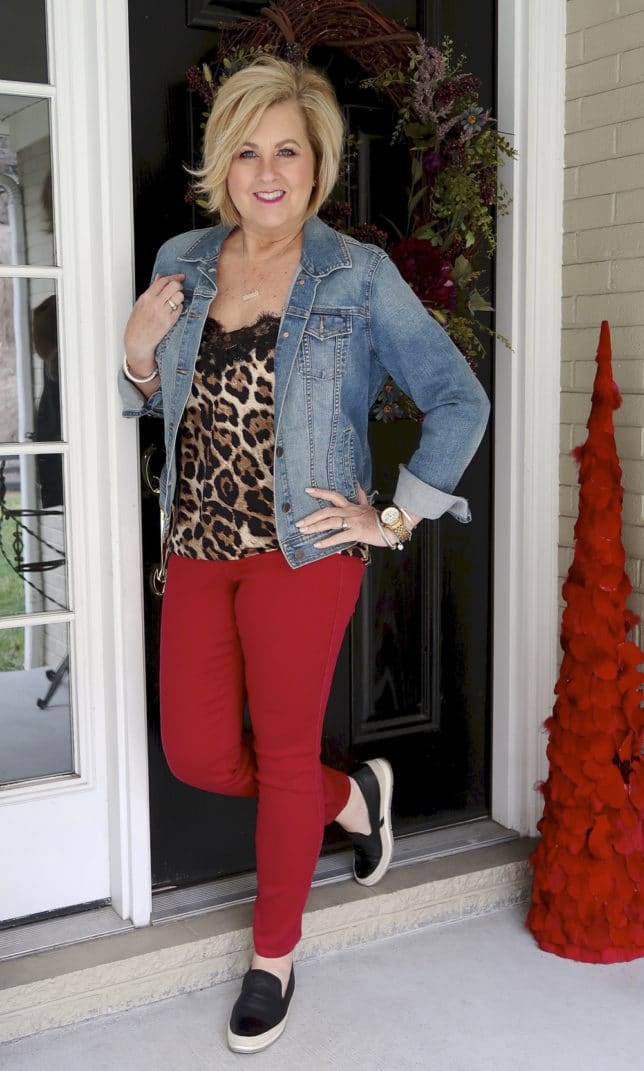 For the month of love, fashion blogger 50 Is Not old is wearing red jeans and a denim jacket