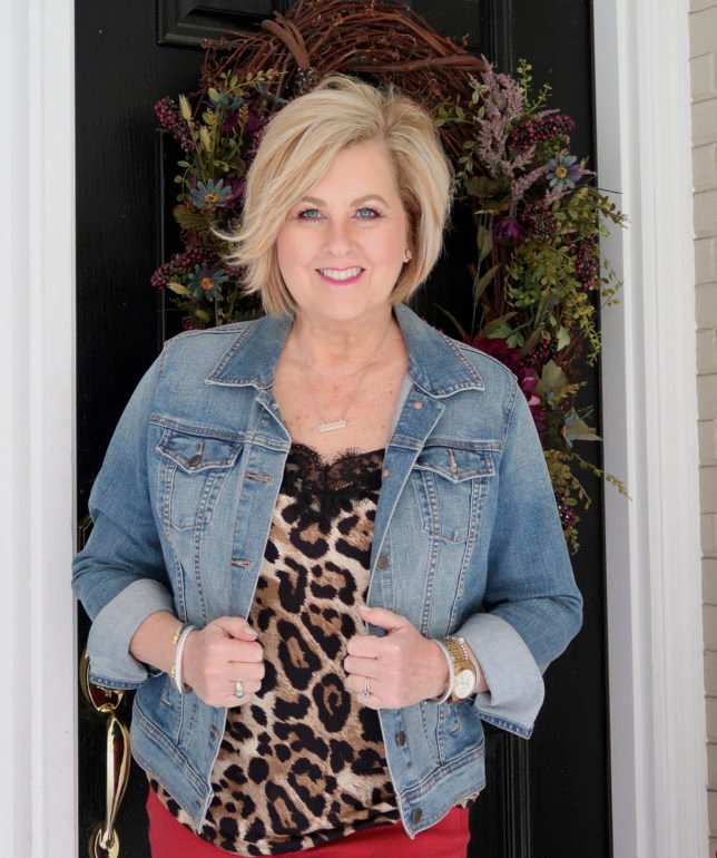 For the month of love, fashion blogger 50 Is Not old is wearing a leopard camisole and a denim jacket