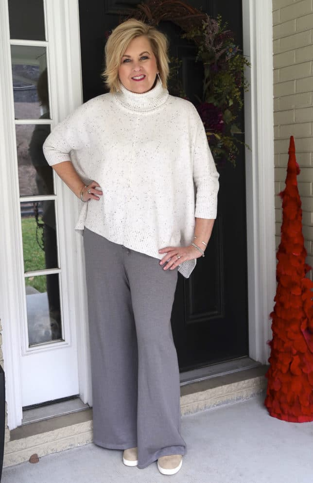 50 Is Not Old is traveling in comfort with this cowl neck poncho sweater and gray lounge pants