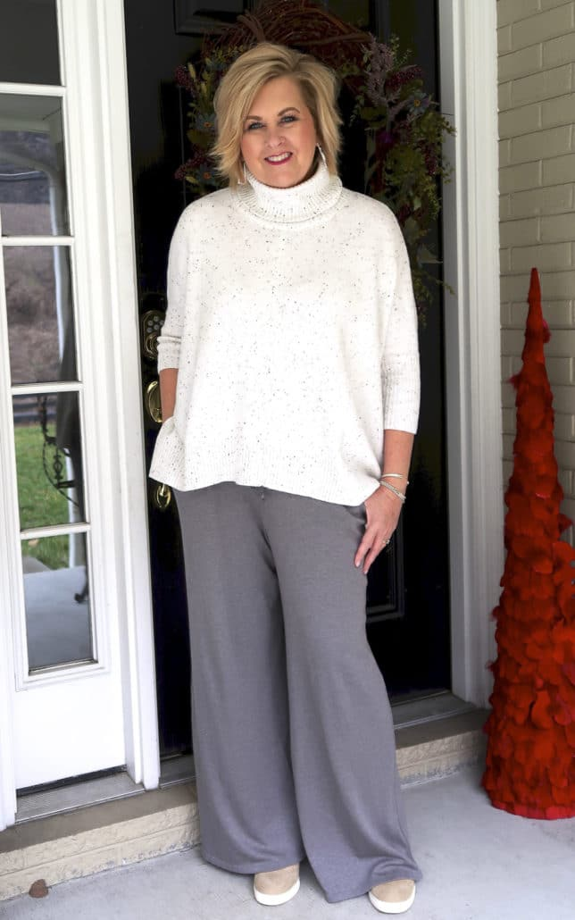 50 Is Not Old is traveling in comfort with this poncho sweater and lounge pants