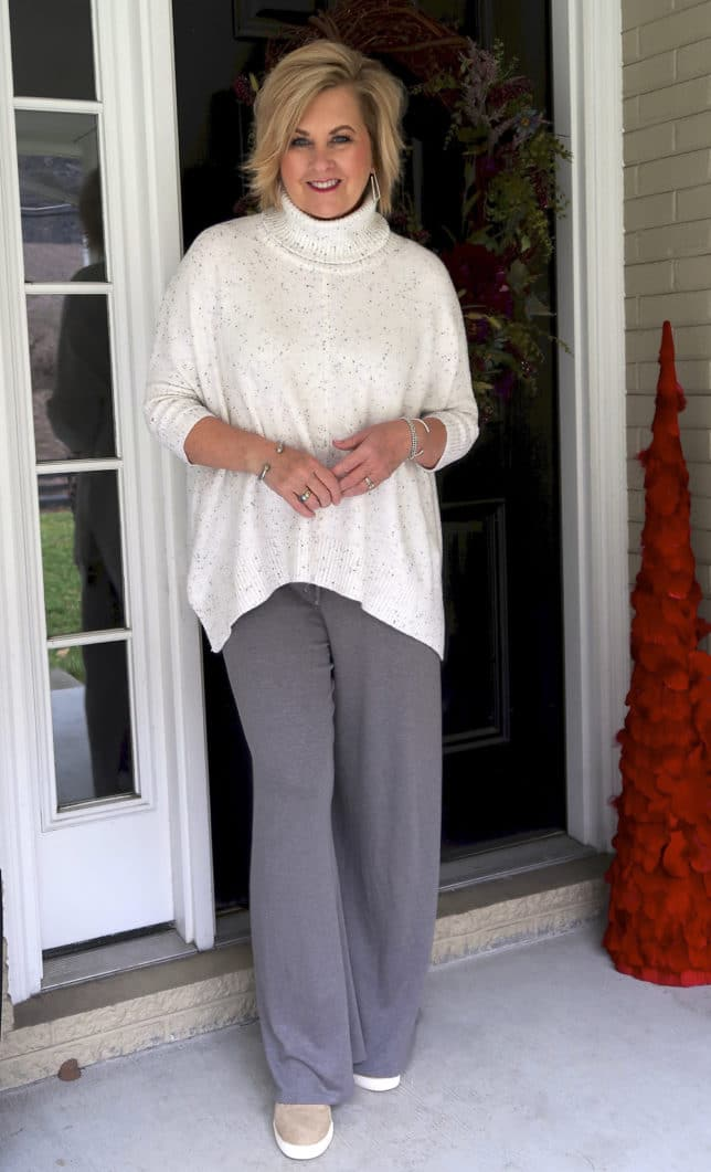 50 Is Not Old is traveling in comfort with this cowl neck poncho sweater and lounge pants