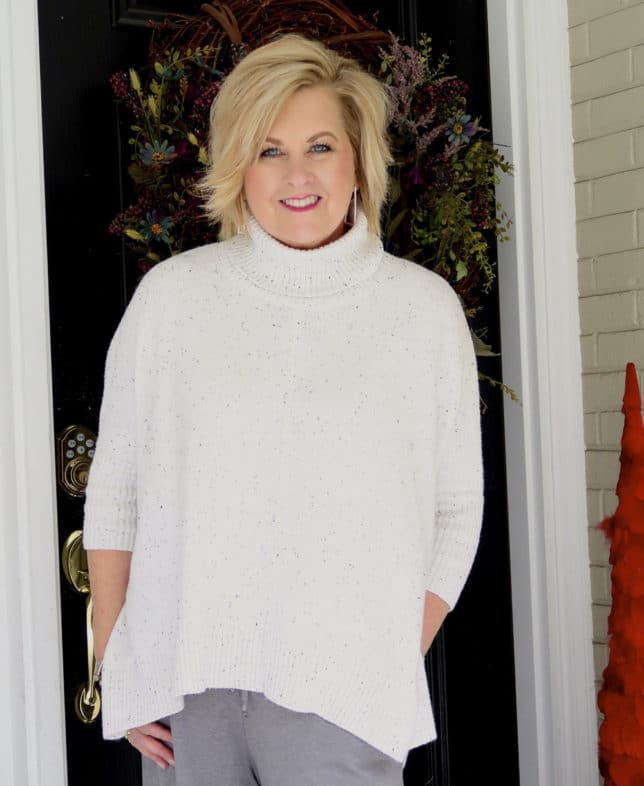 50 Is Not Old is traveling in comfort with this cowl neck poncho sweater from Loft