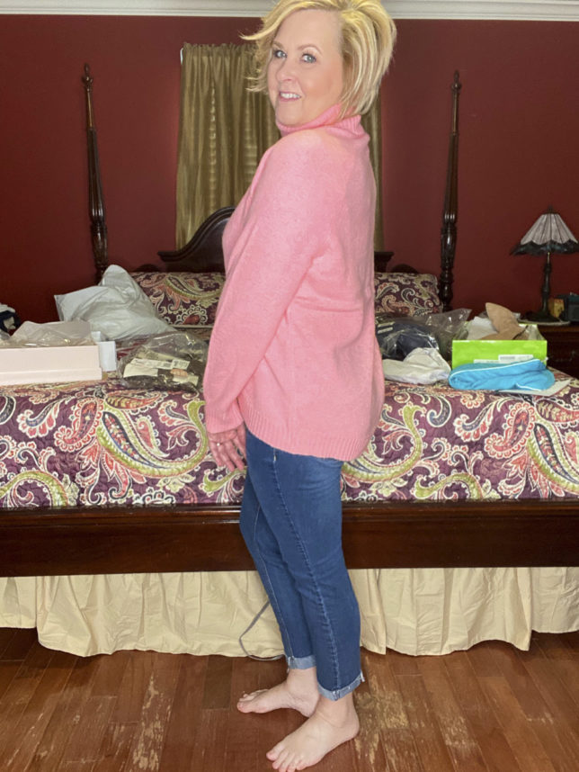 Side view of pink turtleneck sweater worn by fashion blogger 50 Is Not Old