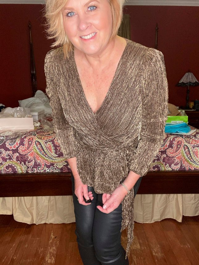 A gold pleated metallic wrap top worn by fashion blogger 50 Is Not Old