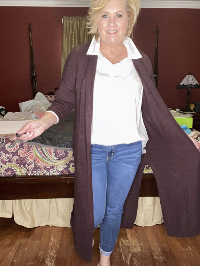 A white shirt with jeans and a burgundy long cardigan worn by fashion blogger 50 Is Not Old