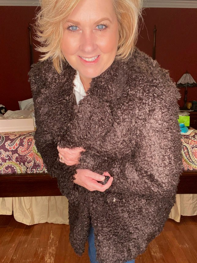 Close up of brown teddy jacket worn by fashion blogger 50 Is Not Old