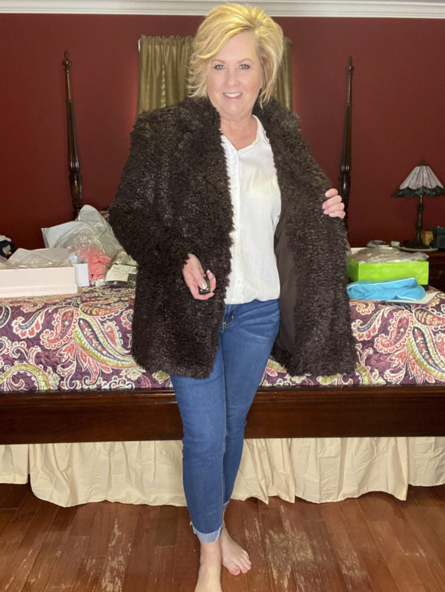 A brown teddy coat with jeans worn by fashion blogger 50 Is Not Old