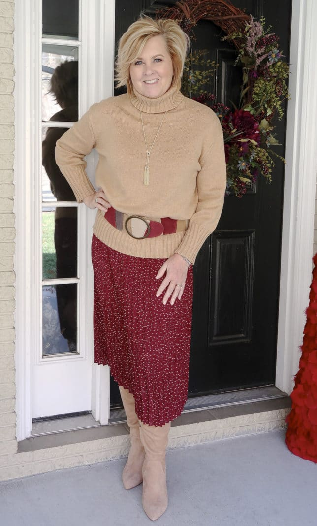 A classic turtleneck sweater and a burgundy skirt worn by fashion blogger 50 Is Not Old