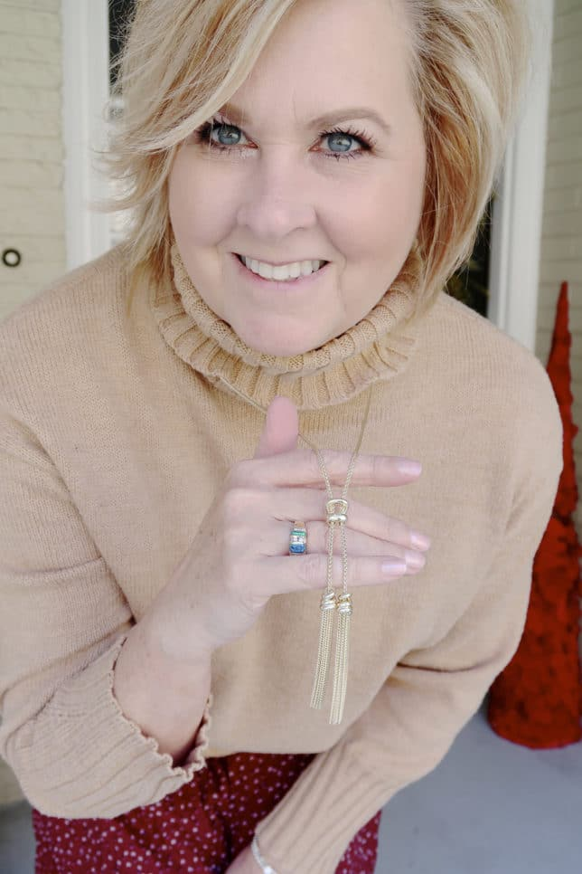 A classic turtleneck sweater with a gold tassel necklace by Kendra Scott worn by fashion blogger 50 Is Not Old