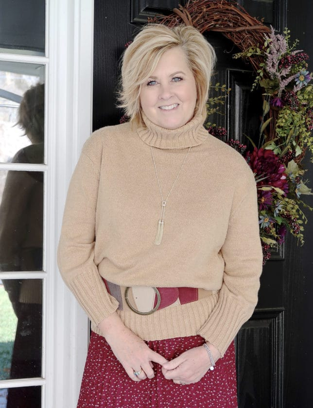 A classic turtleneck sweater belted worn by fashion blogger 50 Is Not Old