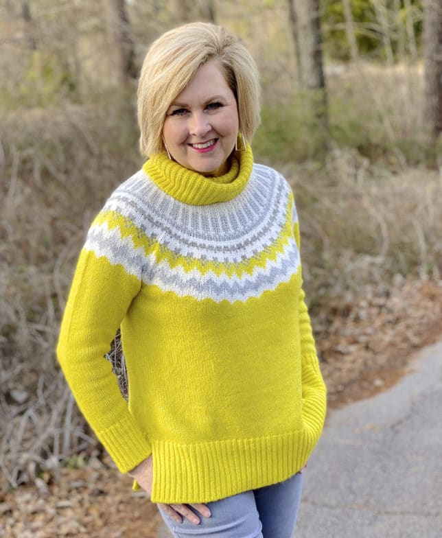 Fashion Blogger 50 Is Not Old wearing a yellow turtleneck Fairisle sweater from The Loft