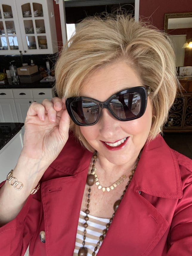 Fashion Blogger 50 Is Not Old wearing a pair of Versace sunglasses