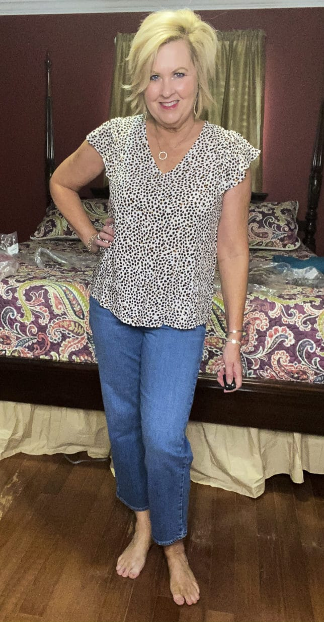 Old Navy try-on haul by Fashion Blogger 50 Is Not Old and she is wearing a leopard print flutter sleeve top and a pair of wide leg crop jeans