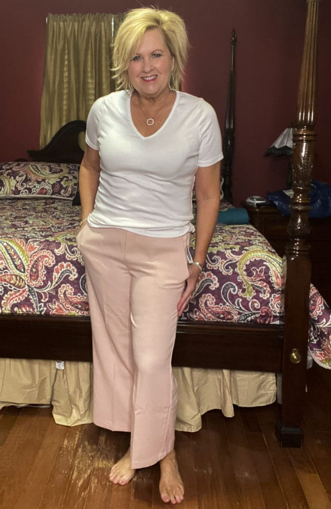 Old Navy try-on haul by Fashion Blogger 50 Is Not Old and she is wearing a white v-neck t-shirt and a pair of pale pink wide leg crop pants