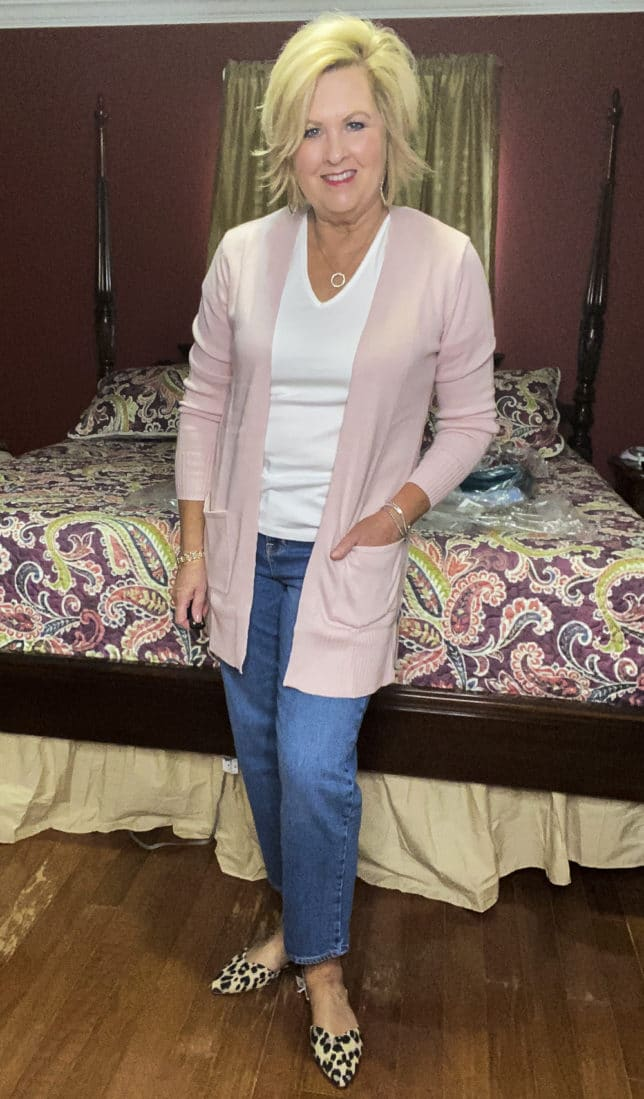 Old Navy try-on haul by Fashion Blogger 50 Is Not Old and she is wearing a soft pink open front cardigan and a pair of wide leg crop jeans