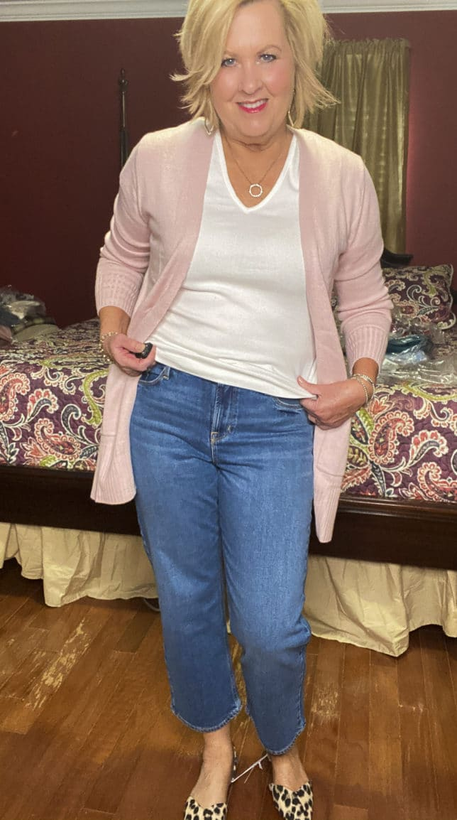 Old Navy try-on haul by Fashion Blogger 50 Is Not Old and she is wearing a soft pink open front cardigan, a white t-shirt, and a pair of wide leg crop jeans