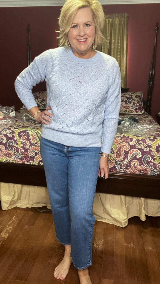 Old Navy try-on haul by Fashion Blogger 50 Is Not Old and she is wearing a sky blue pointelle sweater and a pair of wide leg crop jeans
