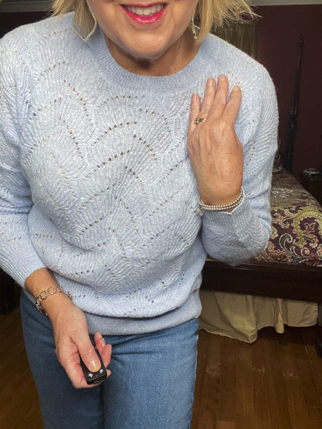 Old Navy try-on haul by Fashion Blogger 50 Is Not Old and she is wearing a Pointelle sweater in sky blue