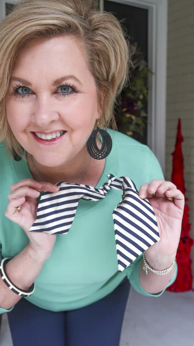 Fashion Blogger 50 Is Not Old wearing a Jade sweater with a striped silk scarf
