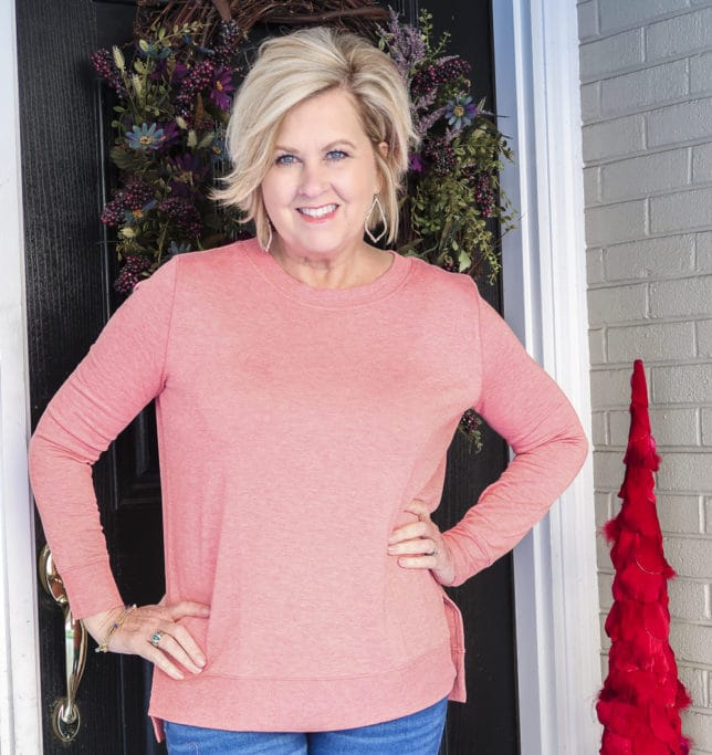 Fashion Blogger 50 Is Not Old is wearing a super soft rose/coral tunic top