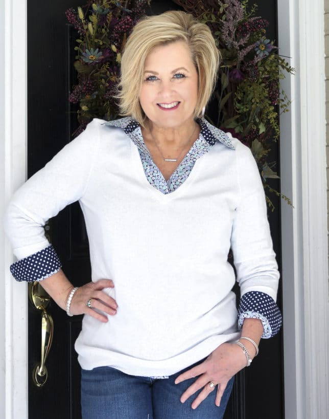 Fashion Blogger 50 Is Not Old wearing a floral shirt from Talbots and a white v-neck sweater