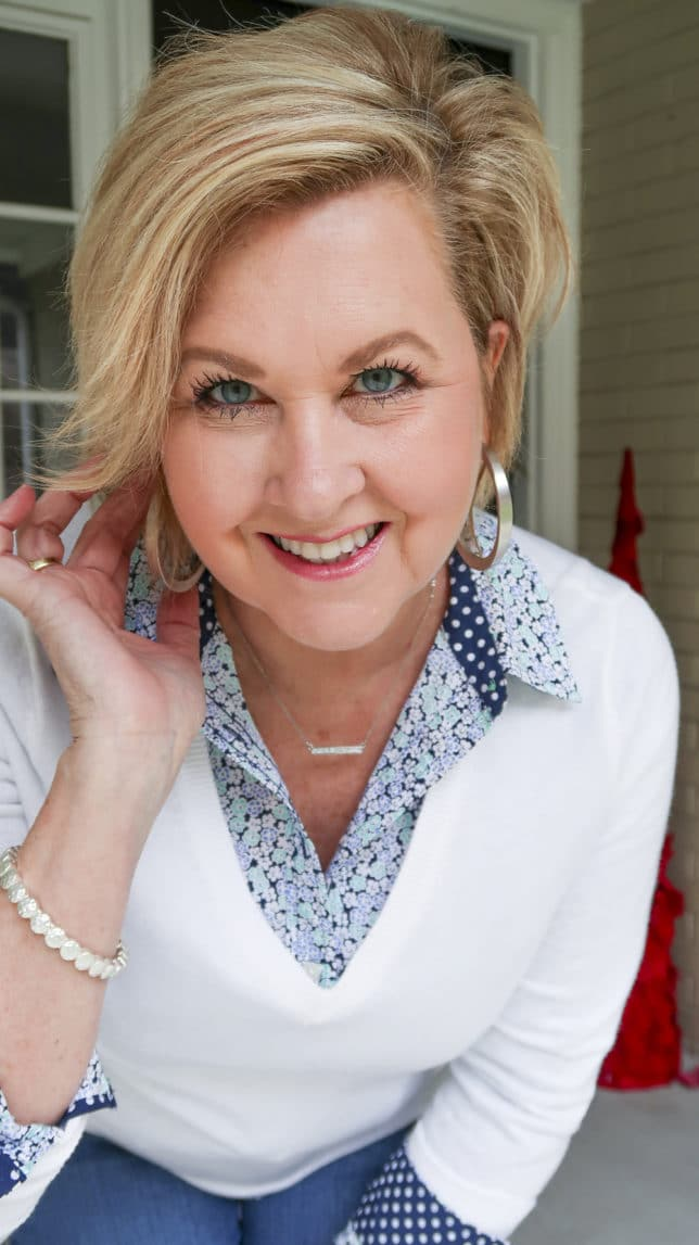 Fashion Blogger 50 Is Not Old wearing a floral shirt with silver hoops from Kendra Scott