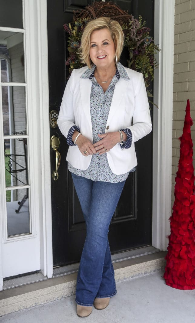 Fashion Blogger 50 Is Not Old wearing a floral shirt and a white blazer