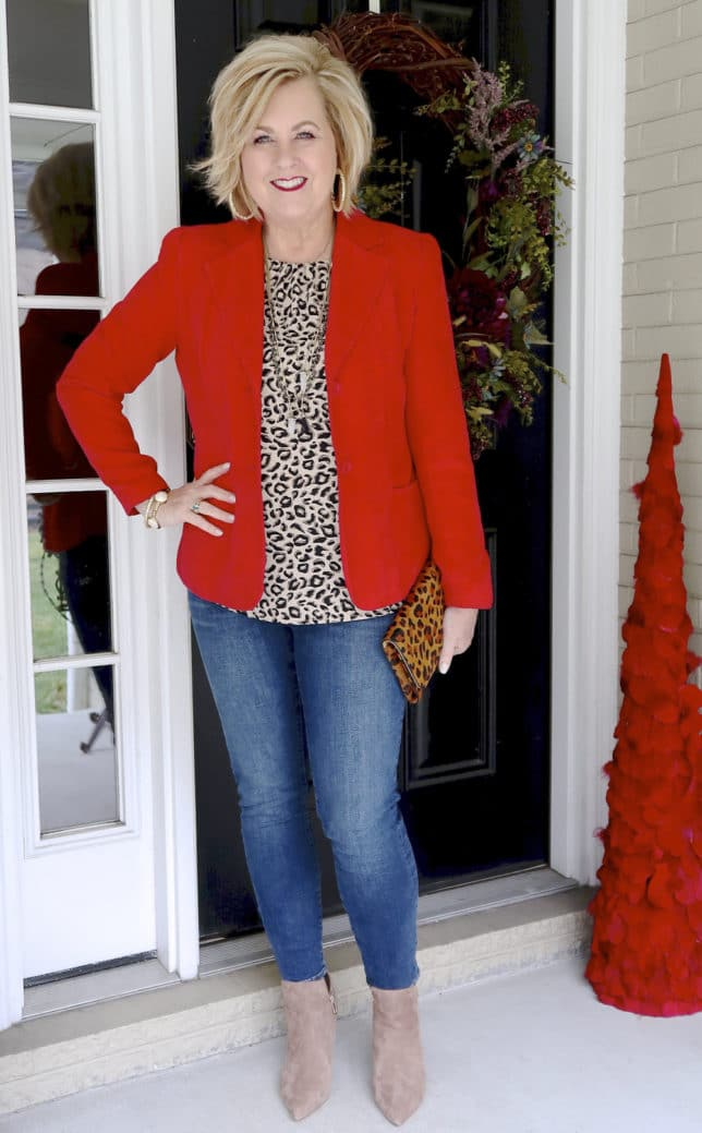 Fashion Blogger 50 Is Not Old is wearing a red blazer and a leopard print top to a Galentine party
