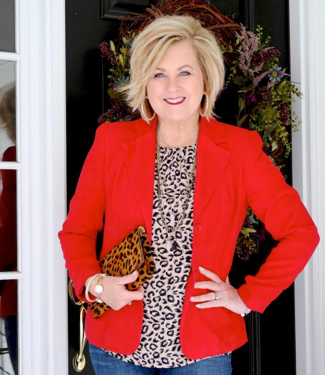 Fashion Blogger 50 Is Not Old is wearing a bright red blazer, a leopard print top, and a leopard clutch to a Galentine party