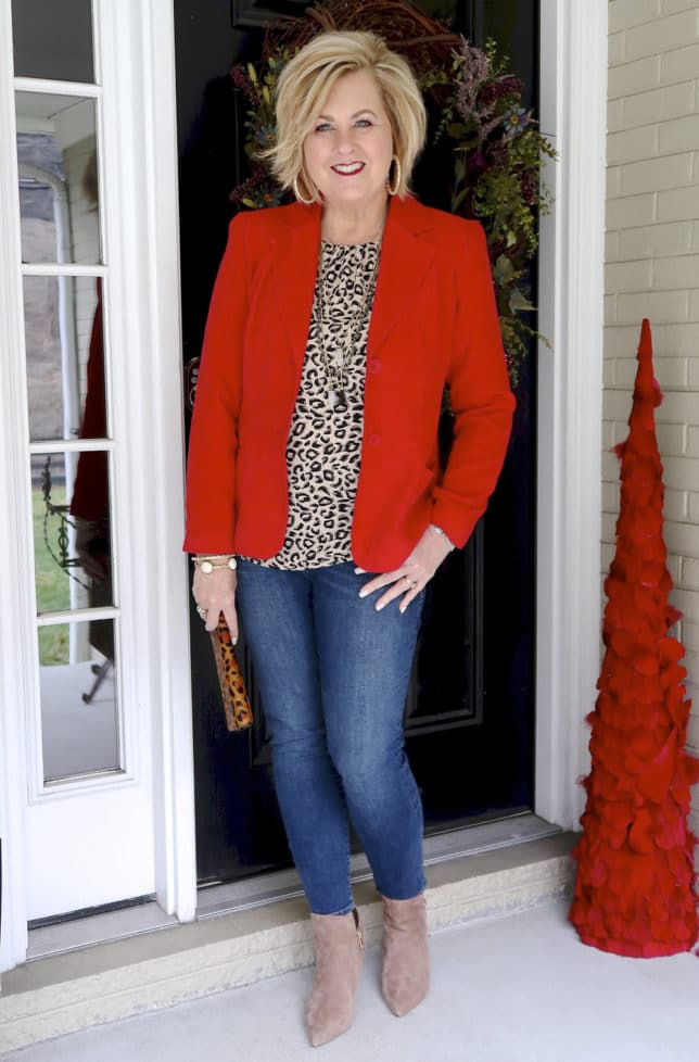 Fashion Blogger 50 Is Not Old is wearing a leopard print top and a red blazer to a Galentine party