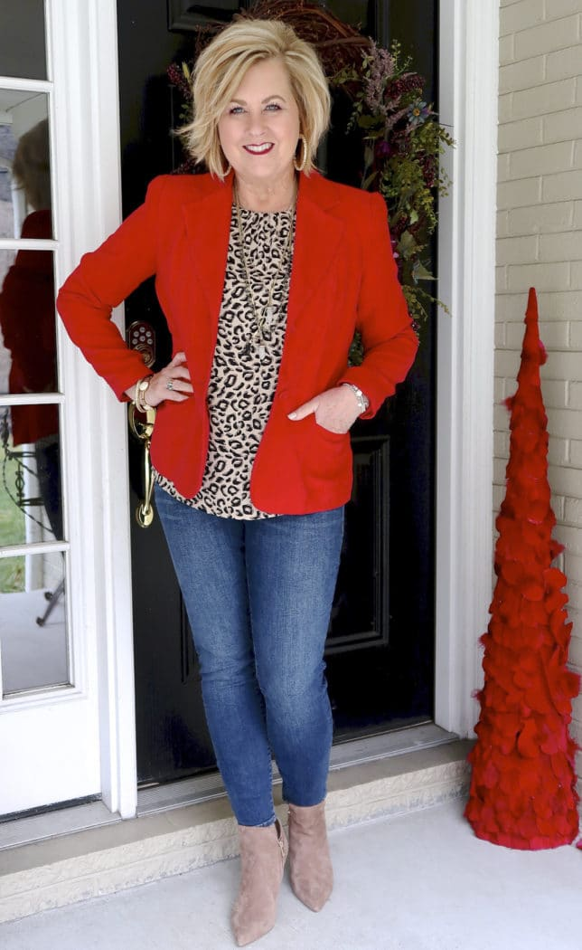 Fashion Blogger 50 Is Not Old is wearing a red blazer and a leopard print top with skinny jeans and ankle boots to a Galentine party