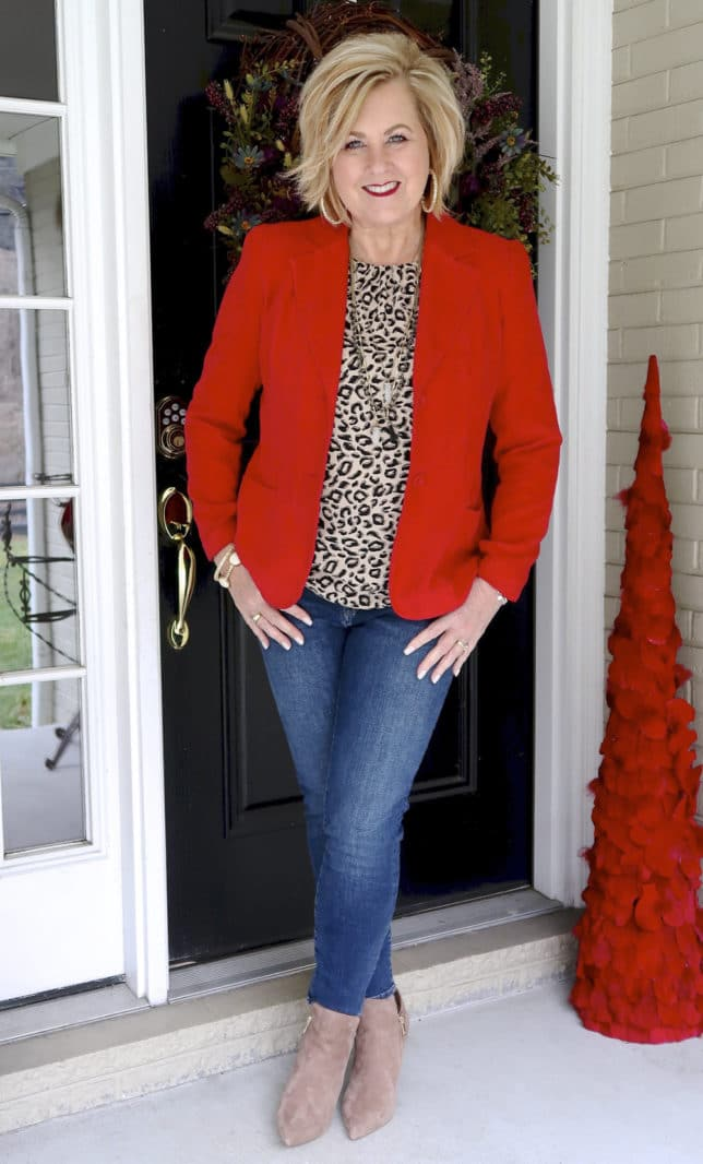 Fashion Blogger 50 Is Not Old is wearing a red blazer, a leopard print top, and skinny jeans to a Galentine party
