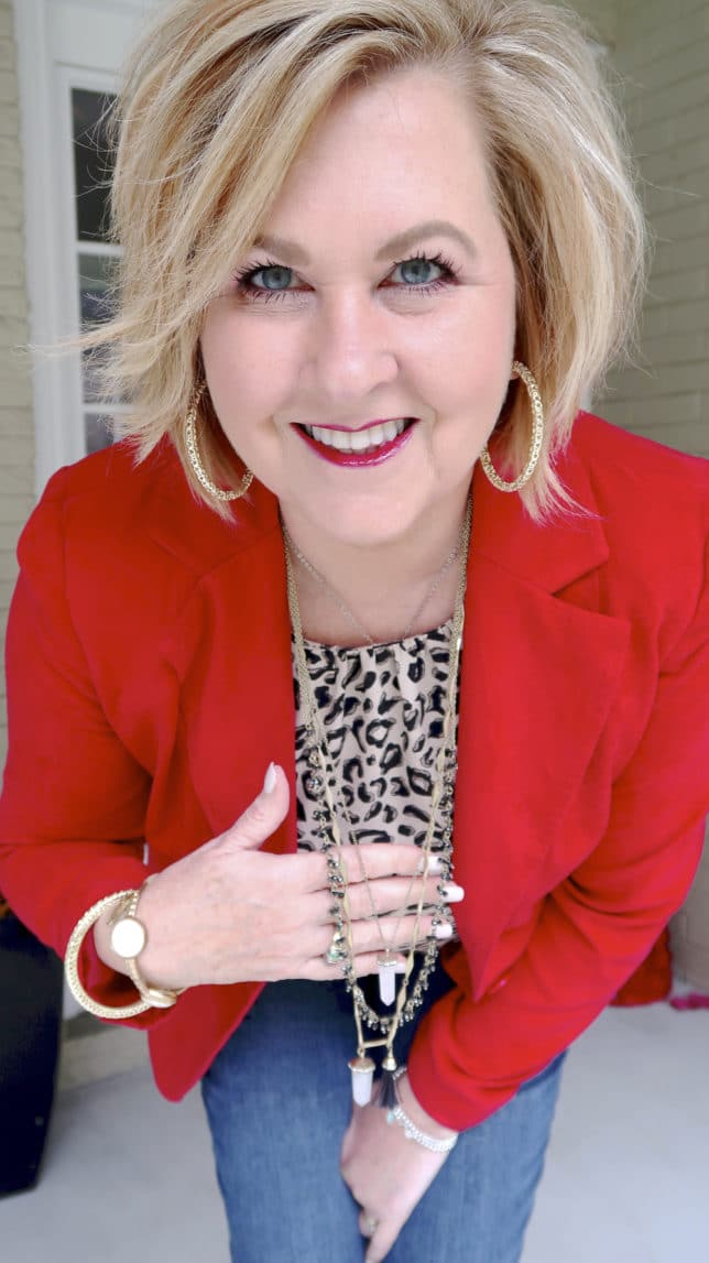 Fashion Blogger 50 Is Not Old is wearing a red blazer and a leopard print top with gold jewelry to a Galentine party