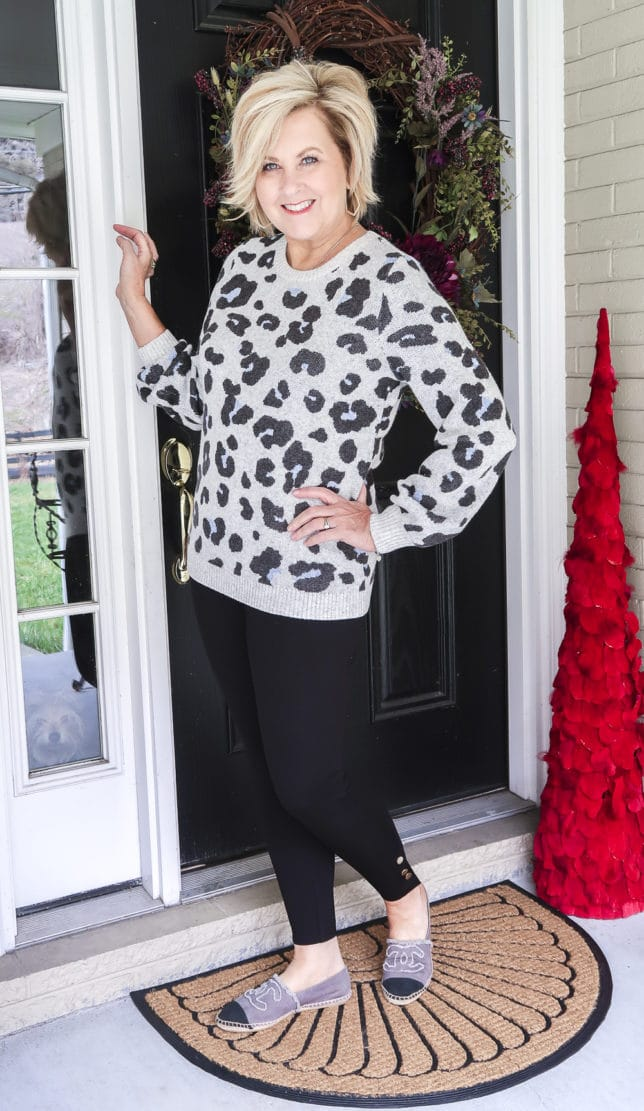 Fashion Blogger 50 Is Not Old wearing a leopard print sweater, a pair of black leggings, and Chanel espadrilles