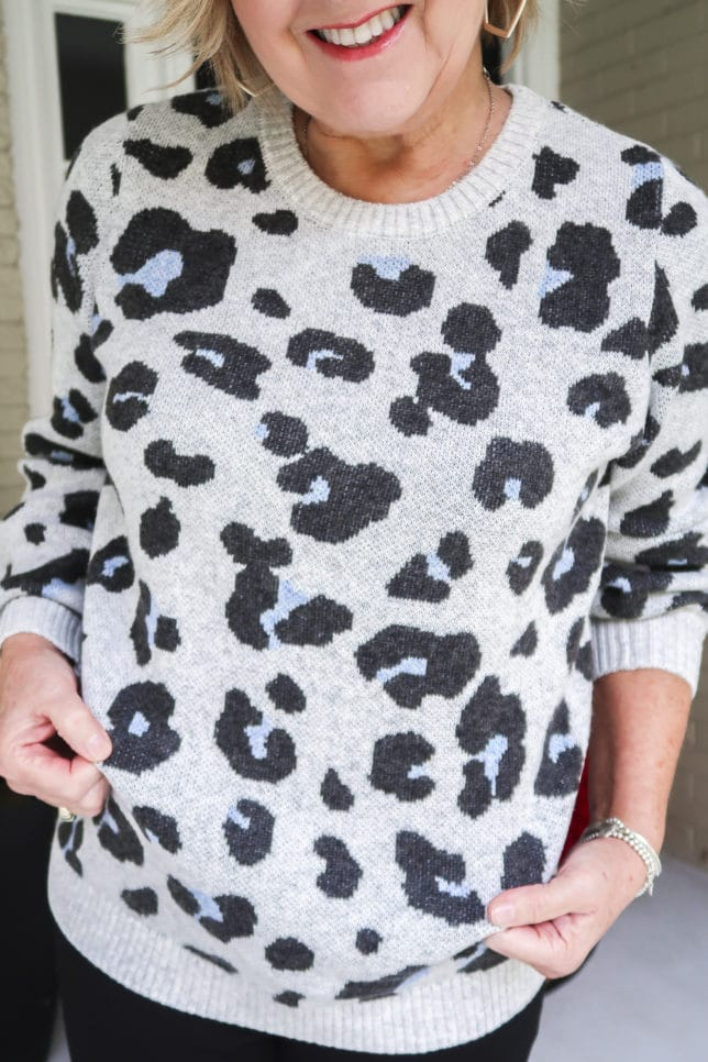 Fashion Blogger 50 Is Not Old wearing a gray and blue leopard print sweater