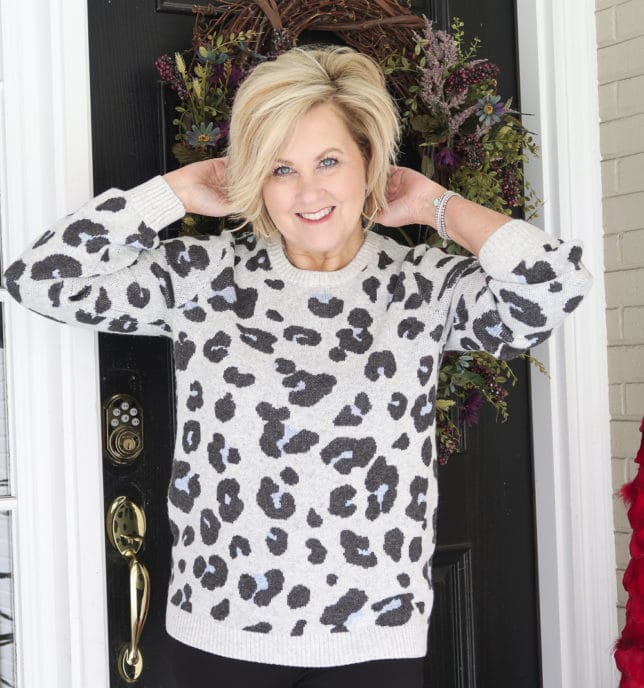 Fashion Blogger 50 Is Not Old wearing a gray leopard print sweater