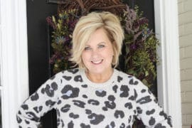Fashion Blogger 50 Is Not Old wearing a leopard print sweater