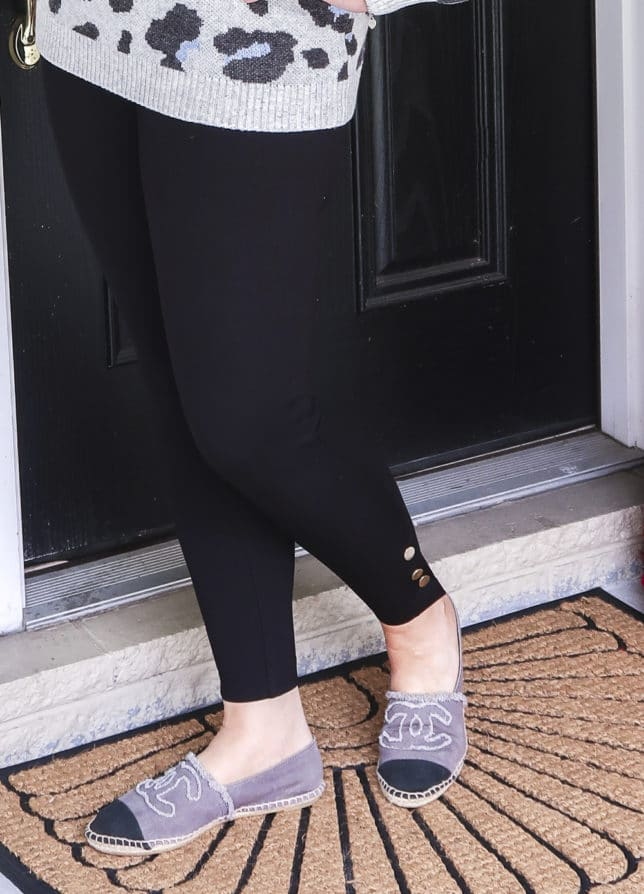 Fashion Blogger 50 Is Not Old wearing a pair of black leggings with snaps at the hem by Chicos