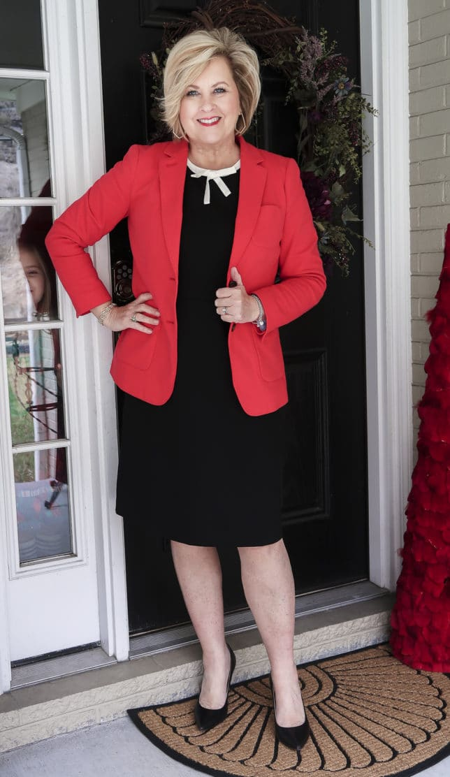 Fashion Blogger 50 Is Not Old is wearing a black dress and a red blazer from Talbots which is the perfect choice for most occasions