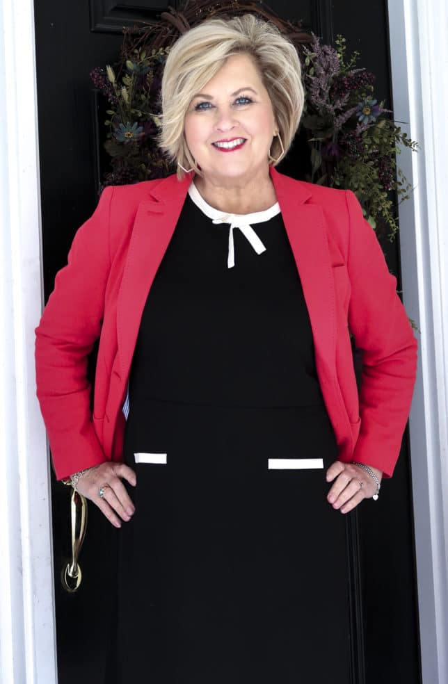 Fashion Blogger 50 Is Not Old is wearing a black dress and a red blazer from Talbots