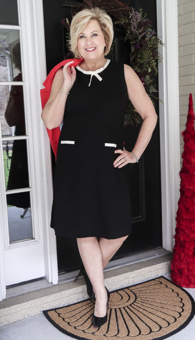 Fashion Blogger 50 Is Not Old is wearing a black dress from Talbots and black pumps