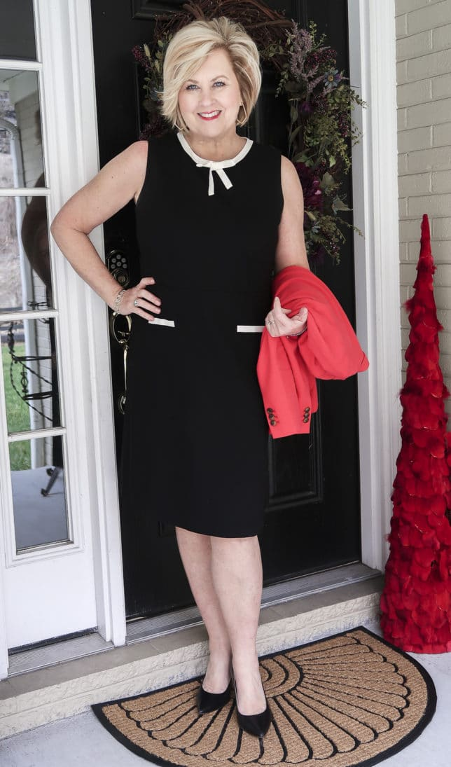 Fashion Blogger 50 Is Not Old is wearing a black dress from Talbots which is the perfect choice for most occasions