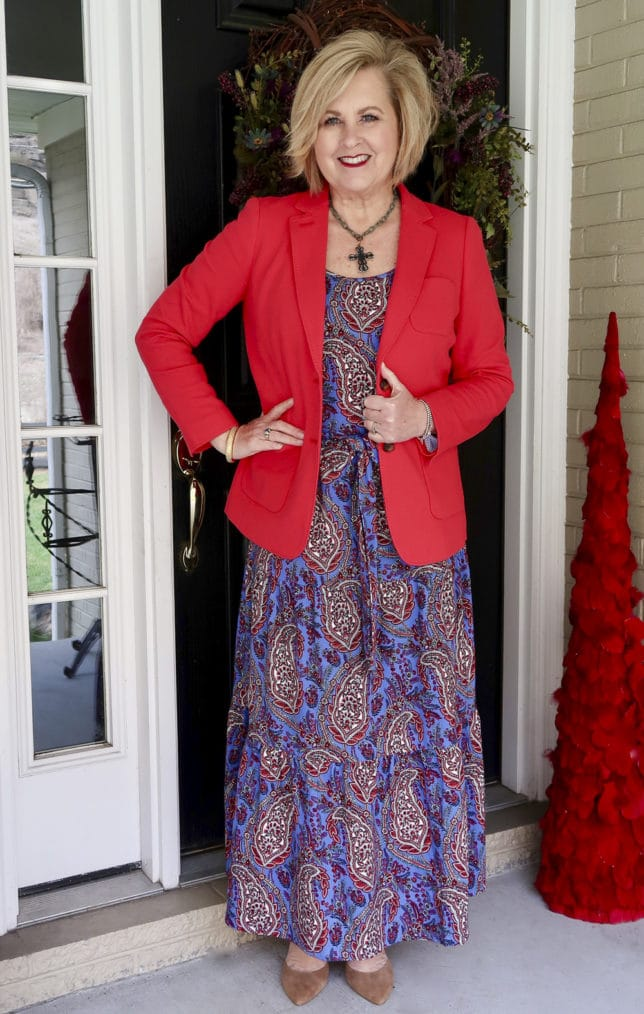 A bright red blazer and a blue paisley spring dress worn by Fashion Blogger 50 Is Not Old
