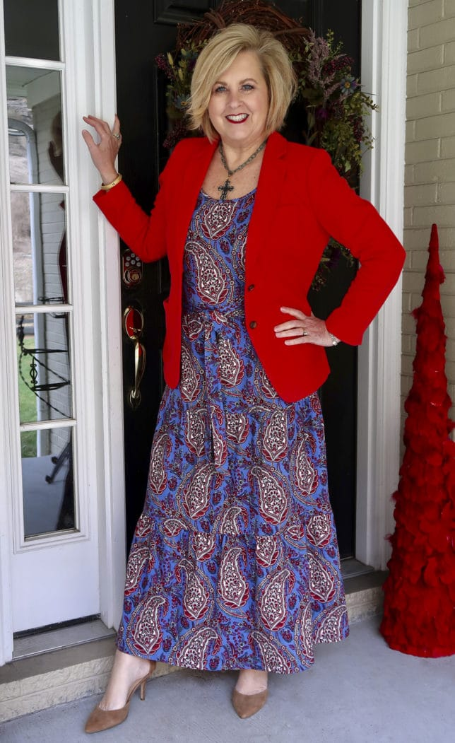 A red blazer and a blue paisley dress perfect for spring worn by Fashion Blogger 50 Is Not Old